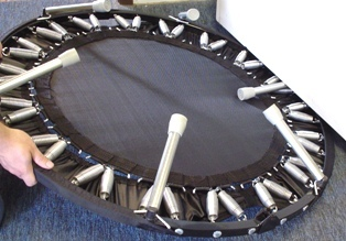 Use a heavy piece of furniture to help close the rebounder